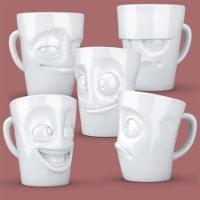 Roliga kaffekoppar med ansikte